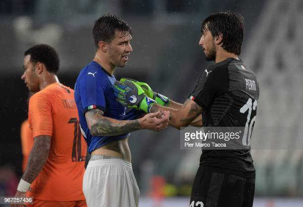 Mattia Perin goalkeeper of Italy speaks with Alessio Romagnoli of Italy during the International Friendly match between Italy and Netherlands at...