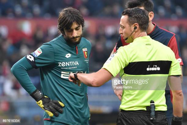 Mattia Perin looks at the watch of referee Abisso during the serie A match between Genoa CFC and Benevento Calcio at Stadio Luigi Ferraris on...