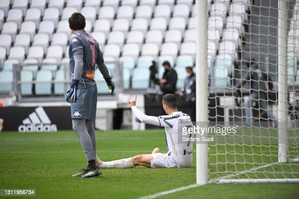 Mattia Perin of Genoa CFC and Cristiano Ronaldo of Juventus FC reacts during the Serie A match between Juventus and Genoa CFC at Allianz Stadium on...