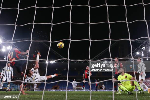Mattia Perin of Genoa CFC looks on as Paulo Dybala of Juventus scores a spectacular overhead kick only for his effort to be disallowed by the referee...