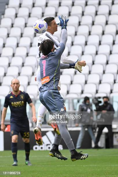 Mattia Perin of Genoa CFC makes a save against Cristiano Ronaldo of Juventus FC during the Serie A match between Juventus and Genoa CFC at Allianz...