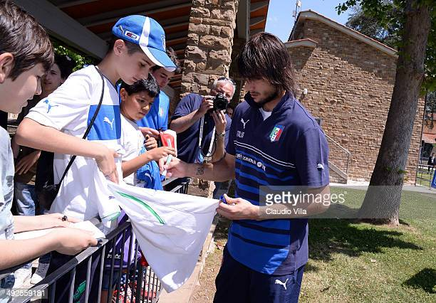 Mattia Perin of Italy sign autographs for fan after a training session at Coverciano on May 21 2014 in Florence Italy