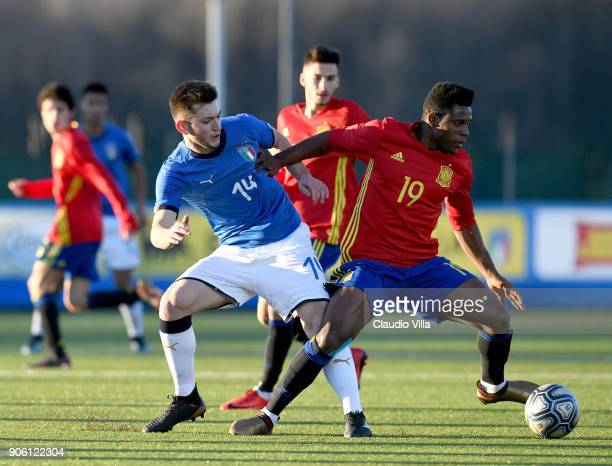 Mattia Sandri of Italy and Cedric Wilfred of Spain compete for the ball during the U17 International Friendly match between Italy and Spain at...
