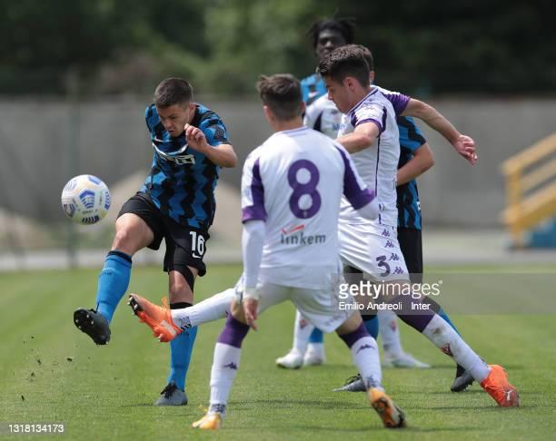 Mattia Sangalli of FC Internazionale is challenged by Niccolo Pierozzi of ACF Fiorentina during the Primavera 1 TIM match between FC Internazionale...