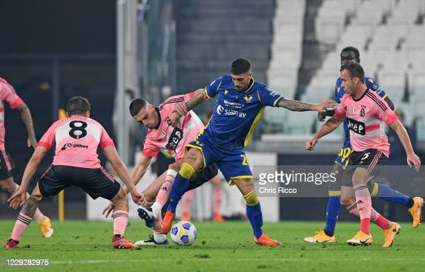 Mattia Zaccagni of Hellas Verona is challenged by Aaron Ramsey Merih Demiral and Arthur of Juventus during the Serie A match between Juventus and...