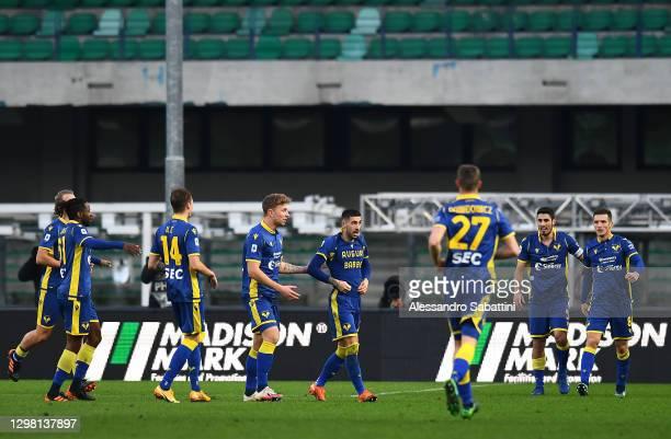 Mattia Zaccagni of Verona celebrates with team mates Matteo Lovato, Marco Davide Faraoni and Darko Lazovic after scoring their side's third goal...