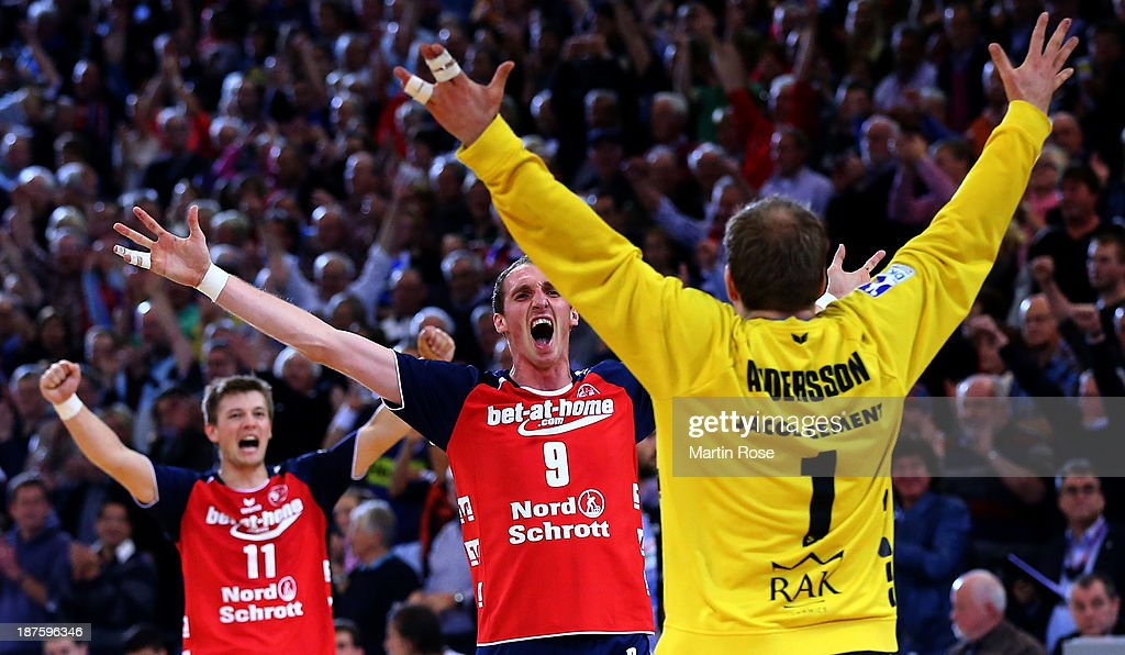Mattias Andersson, goaltender of Flensburg celebrate with team mate Holger Glandorf after the DKB Bundesliga handball match between Flensburg Handewitt and HSV Hamburg at the Flens Arena on November 10, 2013 in Flensburg, Germany.
