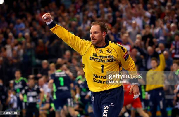 Mattias Andersson goaltender of Flensburg Handewitt celebrates after winning the Velux EHF Champions League round of 16 second leg match between SG...
