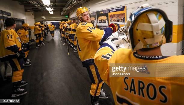 Mattias Ekholm and Juuse Saros of the Nashville Predators prepare for an NHL game against the Vegas Golden Knights at Bridgestone Arena on January 16...