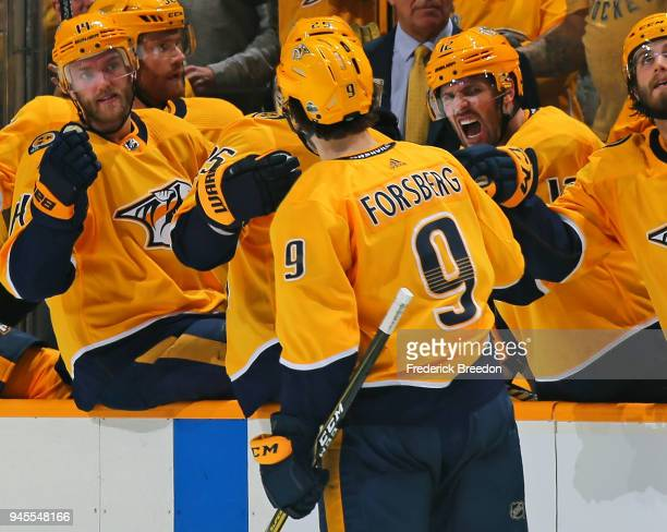 Mattias Ekholm and Mike Fisher celebrate with teammate Filip Forsberg of the Nashville Predators Forsberg's second goal of the game against the...