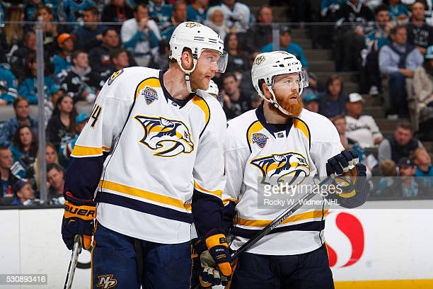 Mattias Ekholm and Ryan Ellis of the Nashville Predators talk during the game against the San Jose Sharks in Game Five of the Western Conference...