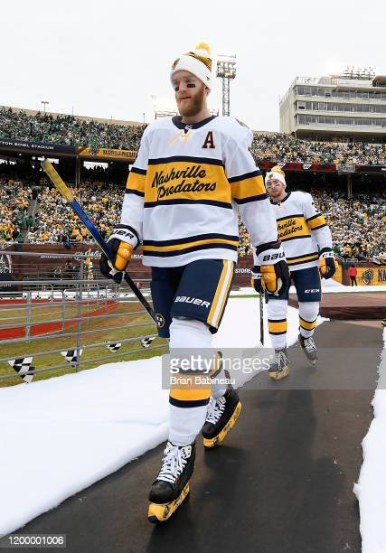 Mattias Ekholm and Yakov Trenin of the Nashville Predators walk back to the locker room after warmup prior to the 2020 NHL Winter Classic between the...