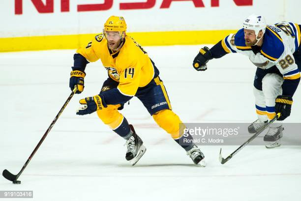 Mattias Ekholm of the Nashville Panthers skates against Kyle Brodziak of the St Louis Blues during an NHL game at Bridgestone Arena on February 13...