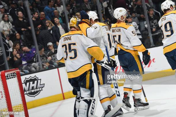 Mattias Ekholm of the Nashville Predators celebrates a victory against the Los Angeles Kings with Pekka Rinne at STAPLES Center on January 6 2018 in...