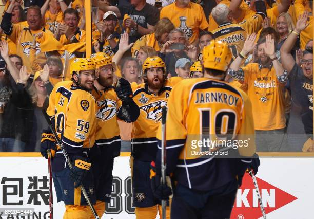 Mattias Ekholm of the Nashville Predators celebrates his third period goal with teammates Roman Josi Colton Sissons and Roman Josi during Game Three...