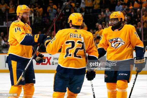 Mattias Ekholm of the Nashville Predators celebrates with teammates Kevin Fiala and PK Subban after a goal against the New York Rangers during the...