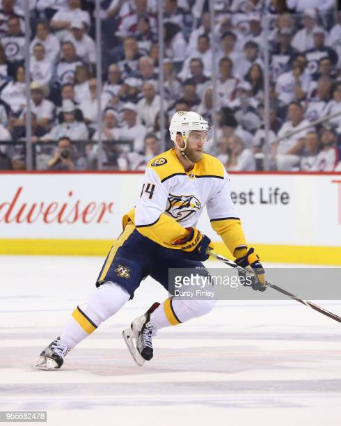 Mattias Ekholm of the Nashville Predators follows the play down the ice during second period action against the Winnipeg Jets in Game Four of the...