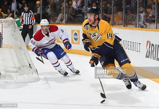 Mattias Ekholm of the Nashville Predators skates against Paul Byron of the Montreal Canadiens during an NHL game at Bridgestone Arena on December 21...
