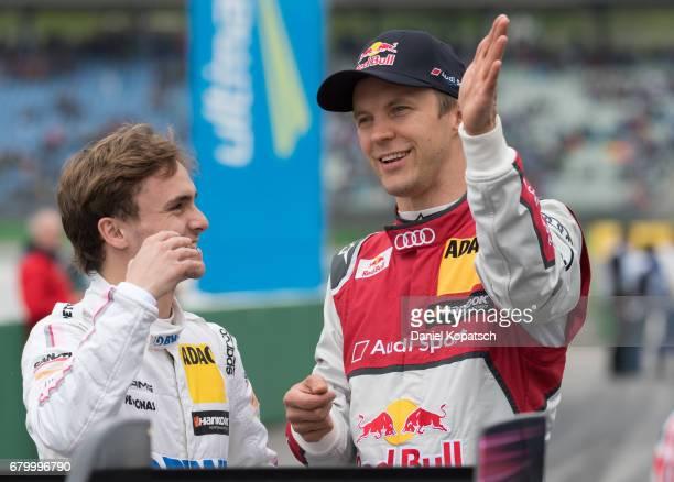 Mattias Ekstroem of Audi Sport Team Abt Sportsline and Lucas Auer of MaercedesAMG Motorsport BWT look on prior to race 2 of the DTM German Touring...