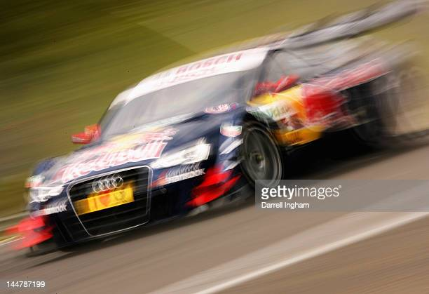 Mattias Ekstrom of Sweden drives the Audi Sport Team ABT Red Bull Audi A5 DTM during practice for the DTM German Touring Car Championship race at the...