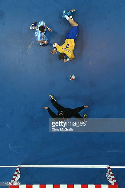 Mattias Gustafsson of Sweden takes a shot at goal passed goalkeeper Fernando Gabriel Garcia of Argentina during the Men's Handball Preliminaries...