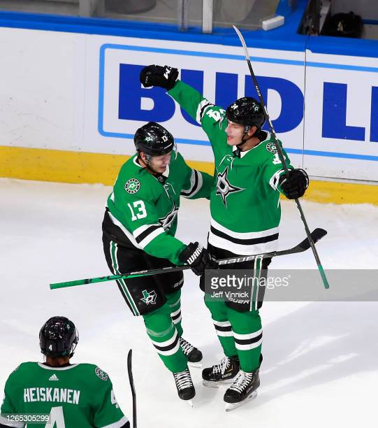 Mattias Janmark and Denis Gurianov of the Dallas Stars celebrate a goal by Joe Pavelski against the Calgary Flames at 1052 of the second period in...