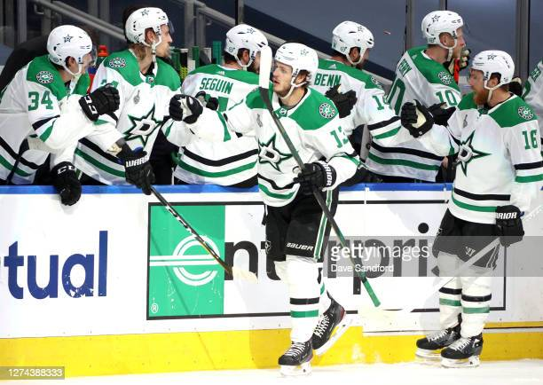 Mattias Janmark and Joe Pavelski of the Dallas Stars celebrate with teammates on the bench after Janmark scored in the third period of Game Two of...