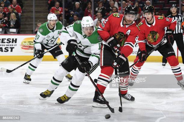 Mattias Janmark of the Dallas Stars and Duncan Keith of the Chicago Blackhawks battle for the puck in the second period at the United Center on...
