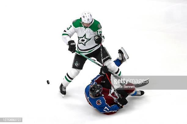 Mattias Janmark of the Dallas Stars and Tyson Jost of the Colorado Avalanche battle for the puck during the second period in Game Seven of the...