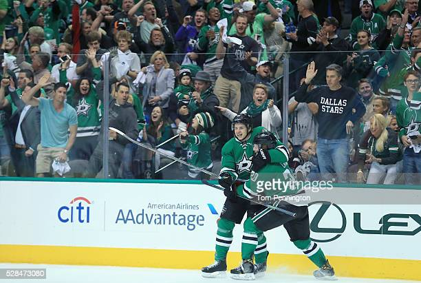 Mattias Janmark of the Dallas Stars celebrates with Cody Eakin of the Dallas Stars after scoring against the St Louis Blues in Game Two of the...