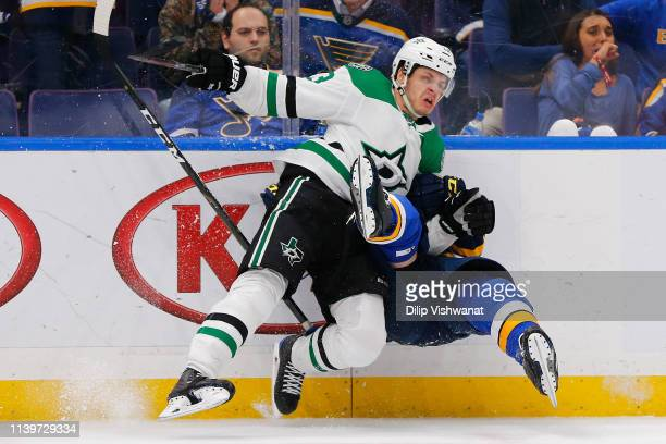 Mattias Janmark of the Dallas Stars checks Vince Dunn of the St Louis Blues in Game Two of the Western Conference Second Round during the 2019 NHL...