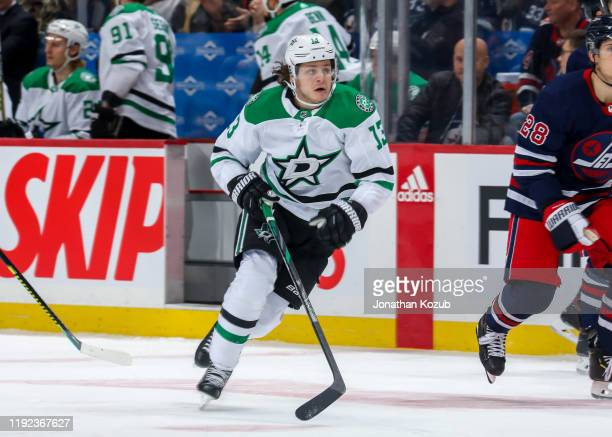 Mattias Janmark of the Dallas Stars follows the play down the ice during first period action against the Winnipeg Jets at the Bell MTS Place on...