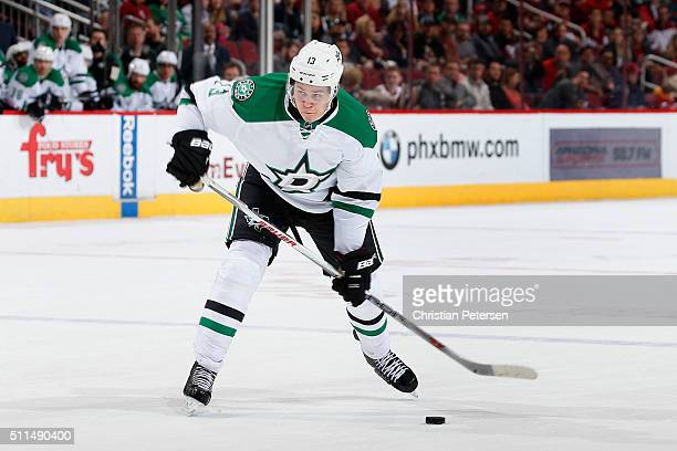 Mattias Janmark of the Dallas Stars handles the puck during the NHL game against the Arizona Coyotes at Gila River Arena on February 18 2016 in...