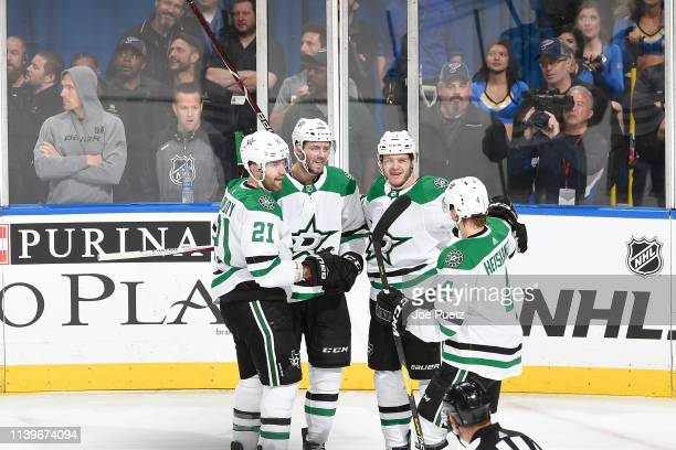 Mattias Janmark of the Dallas Stars is congratulated by teammates after scoring a goal against the St Louis Blues in Game Two of the Western...