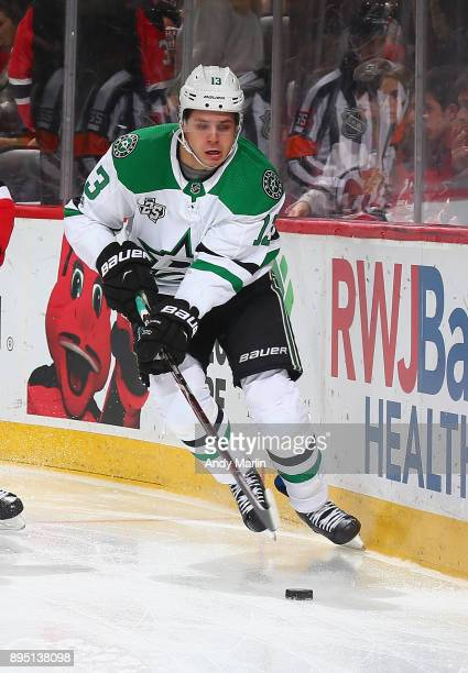 Mattias Janmark of the Dallas Stars plays the puck against the New Jersey Devils during the game at Prudential Center on December 15 2017 in Newark...