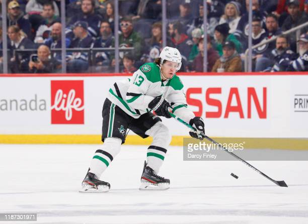 Mattias Janmark of the Dallas Stars plays the puck down the ice during first period action against the Winnipeg Jets at the Bell MTS Place on...