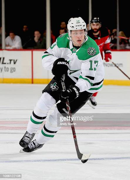 Mattias Janmark of the Dallas Stars plays the puck during the game against the New Jersey Devils at Prudential Center on October 16 2018 in Newark...
