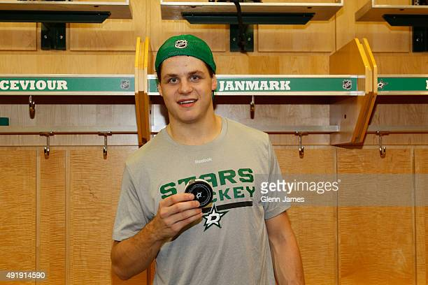 Mattias Janmark of the Dallas Stars poses with his first ever NHL goal puck after a 30 win against the Pittsburgh Penguins at the American Airlines...