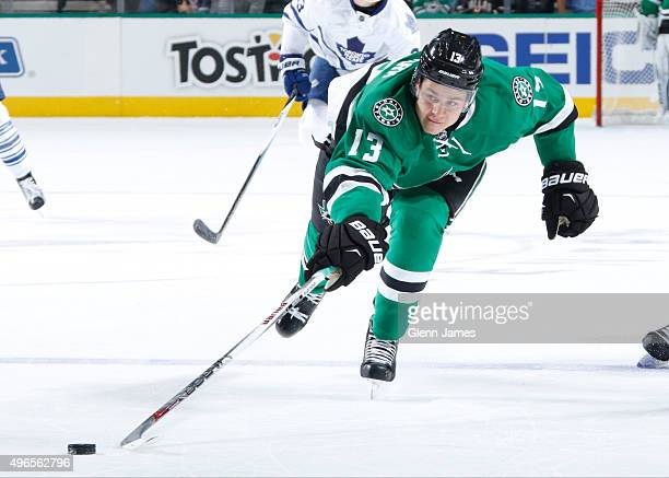 Mattias Janmark of the Dallas Stars reaches for the loose puck against the Toronto Maple Leafs at the American Airlines Center on November 10 2015 in...