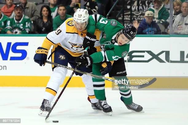 Mattias Janmark of the Dallas Stars skates for the puck against Roman Josi of the Nashville Predators in the first period at American Airlines Center...
