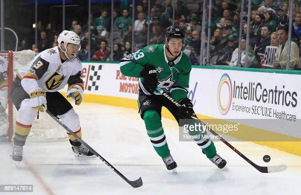 Mattias Janmark of the Dallas Stars skates the puck against Brayden McNabb of the Vegas Golden Knights in the third period at American Airlines...