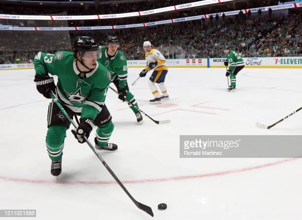 Mattias Janmark of the Dallas Stars skates the puck against the Nashville Predators in the second period at American Airlines Center on March 07 2020...