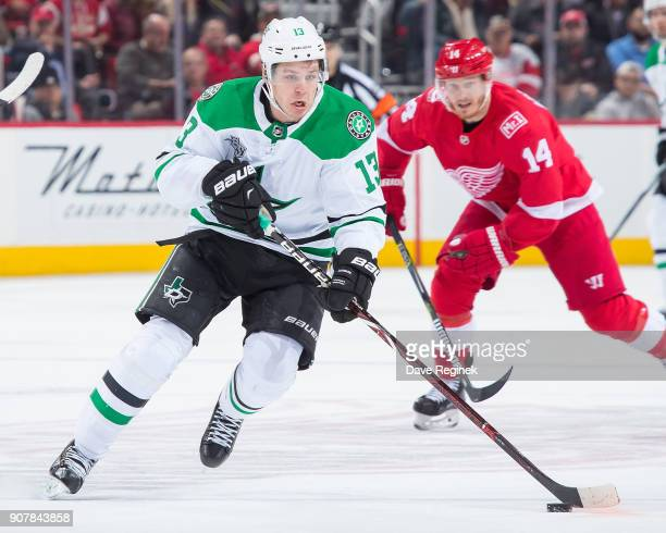 Mattias Janmark of the Dallas Stars skates up ice with the puck against the Detroit Red Wings during an NHL game at Little Caesars Arena on January...