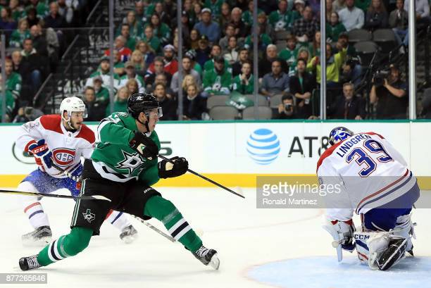 Mattias Janmark of the Dallas Stars takes a shot against Charlie Lindgren of the Montreal Canadiens in the first period at American Airlines Center...