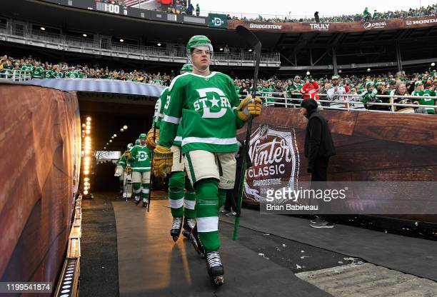 Mattias Janmark of the Dallas Stars walks toward the ice surface for the third period of the 2020 NHL Winter Classic between the Nashville Predators...