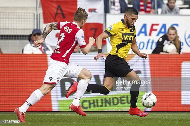 Mattias Johansson of AZ, Adnane Tighadouini of NAC Breda during the Dutch Eredivisie match between AZ Alkmaar and NAC Breda at AFAS stadium on May...