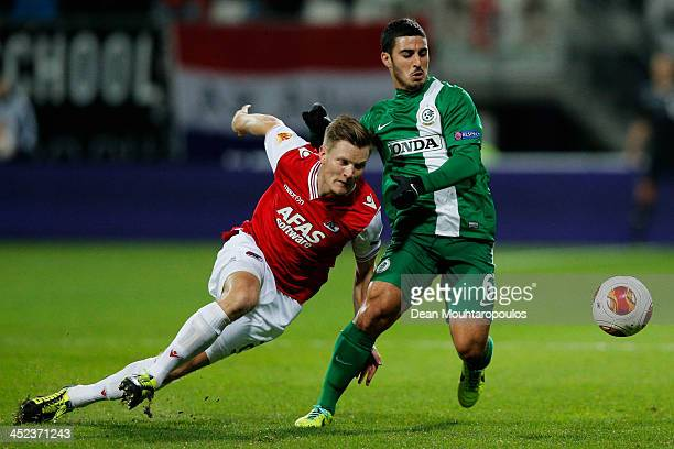 Mattias johansson of AZ and Ran Abukrat of Maccabi Haifa battle for the ball during the UEFA Europa League Group L match between AZ Alkmaar and...