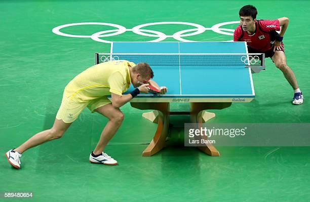 Mattias Karlsson of Sweden competes against Lee Sangsu of Korea during the Table Tennis Men's Quarterfinal Match between Sweden and Korea on August...
