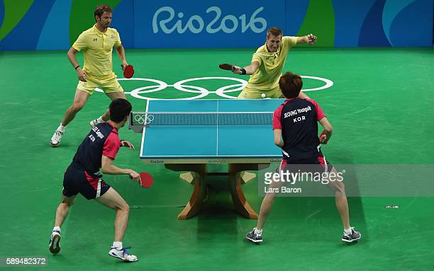 Mattias Karlsson of Sweden competes with Par Gerell against Lee Sangsu and Jeoung Youngsik of Korea during the Table Tennis Men's Quarterfinal Match...