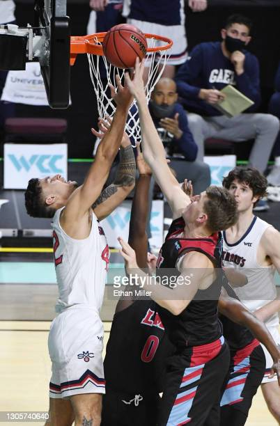 Mattias Markusson of the Loyola Marymount Lions blocks a shot by Dan Fotu of the Saint Mary's Gaels during the West Coast Conference basketball...
